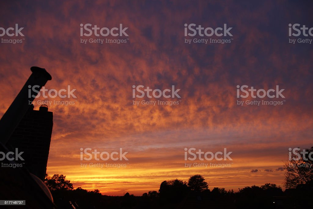 Red glow in the evening sky stock photo