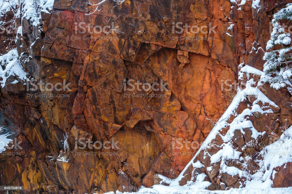 Red granite rock close-up stock photo