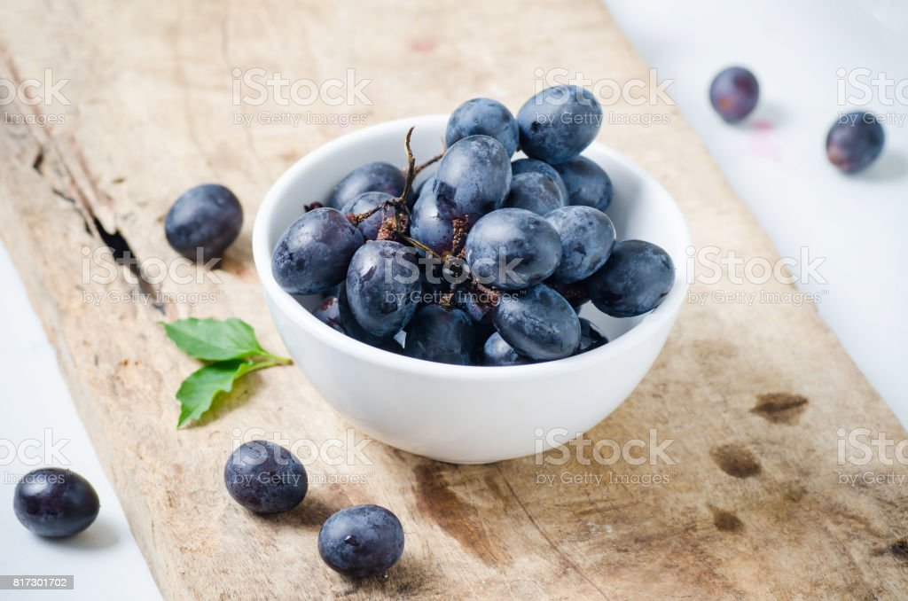 Red grape in a bowl stock photo