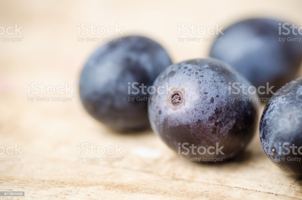 Red grape on wooden background stock photo