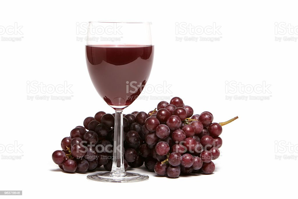 Red grapes and a glass of wine royalty-free stock photo