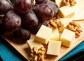 Red grapes, cheeses and walnus