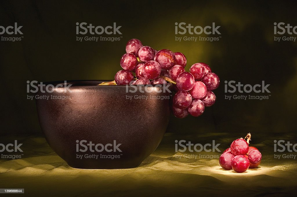 red grapes in black bowl royalty-free stock photo