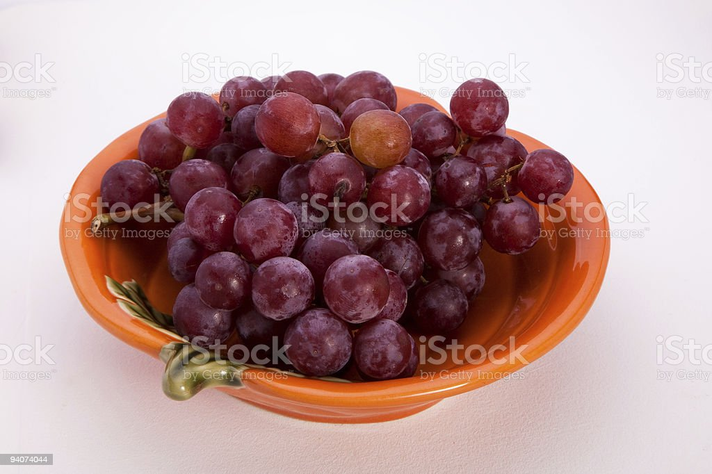 Red grapes in bowl stock photo