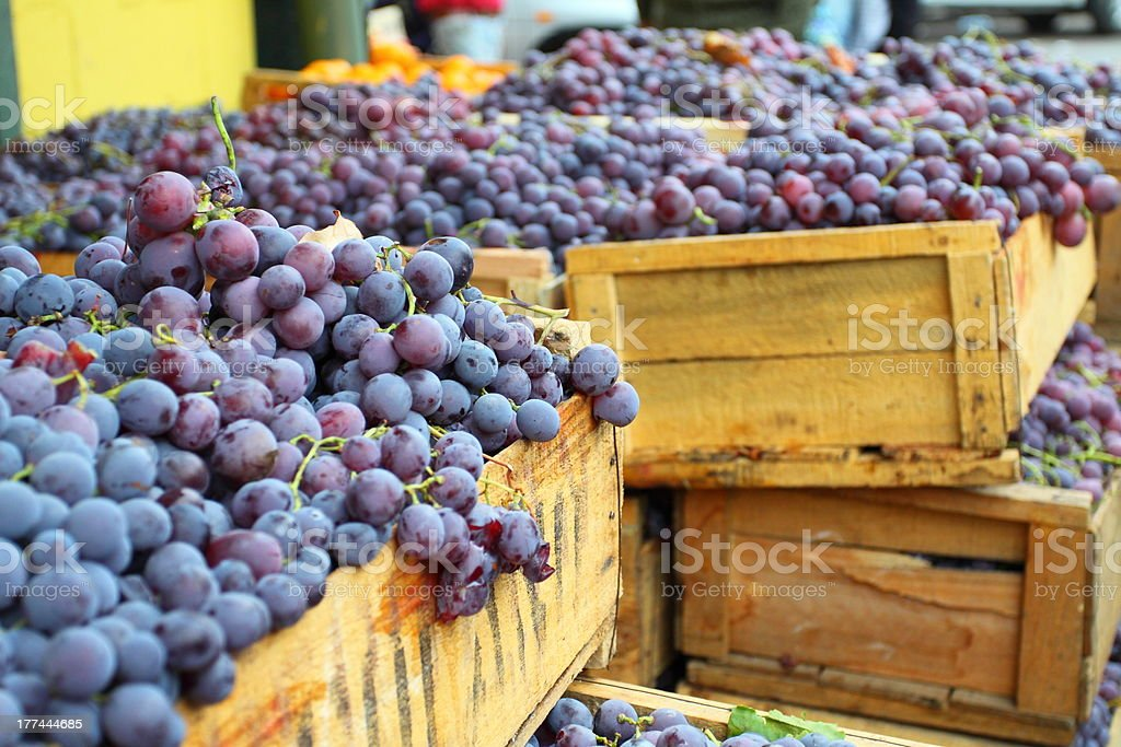 Red grapes in boxes at market in Valparaiso, Chile stock photo