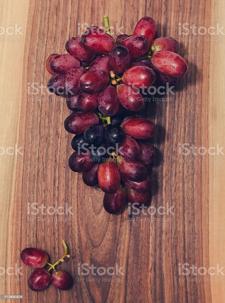Red Grapes on Wood stock photo