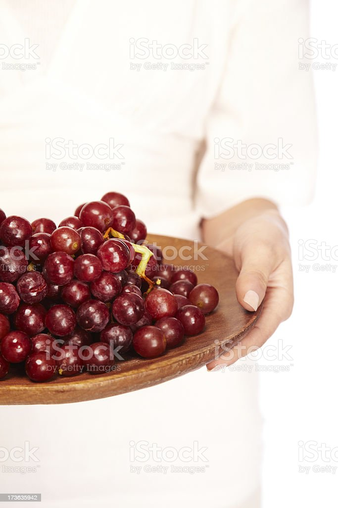 Red grapes on wooden platter royalty-free stock photo