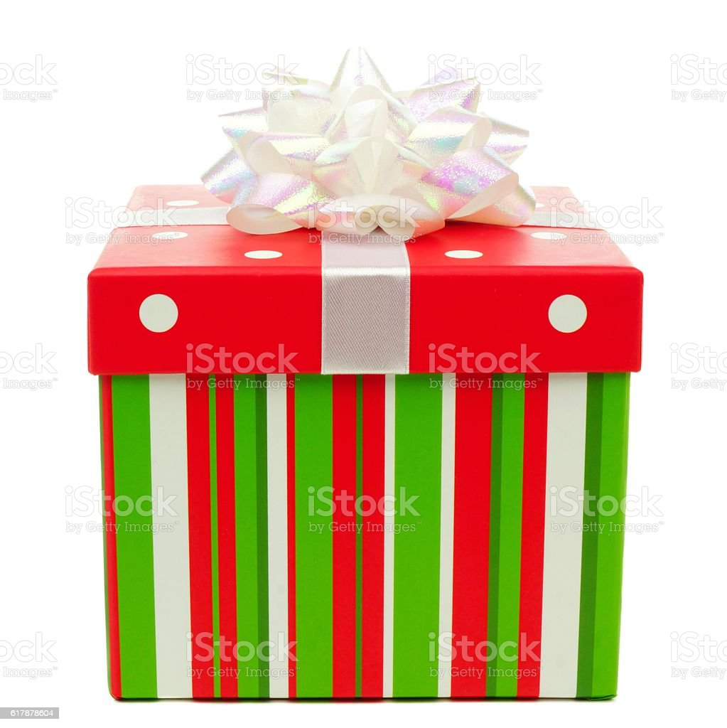 Red, green and white striped Christmas gift box over white stock photo