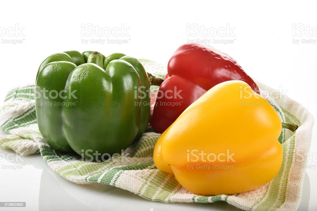 Red, green and yellow peppers stock photo