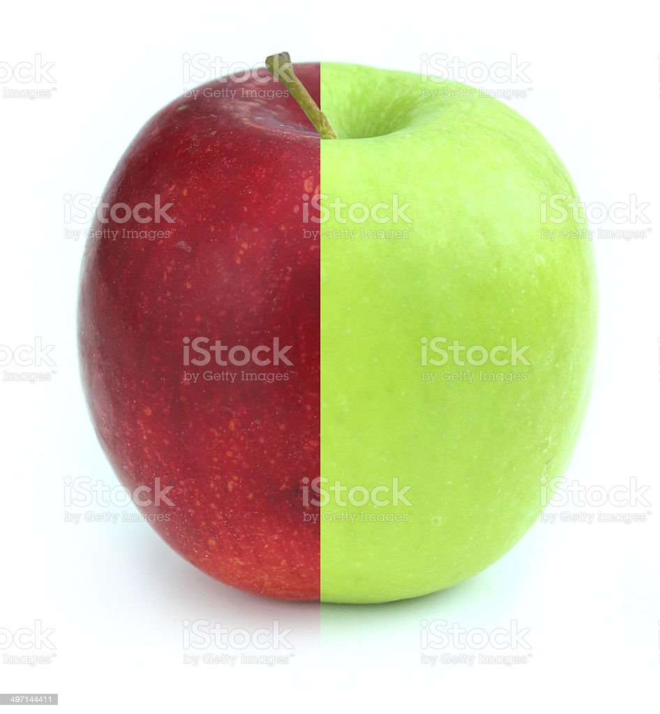 Red / green apple, two halves together, GM food / genetically modified stock photo