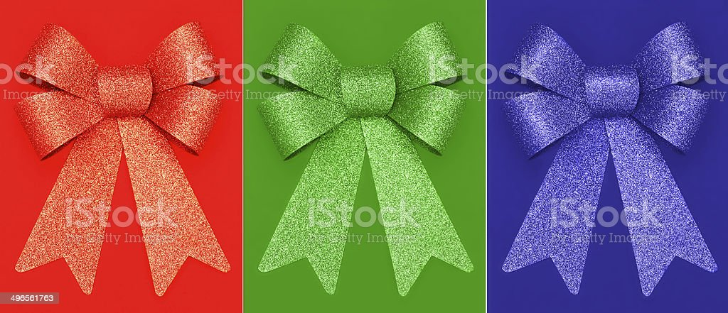 Red, Green, Blue bows on colored background royalty-free stock photo