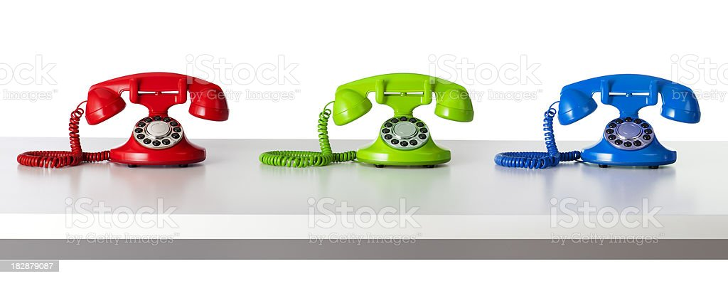 Red Green Blue Telephones stock photo
