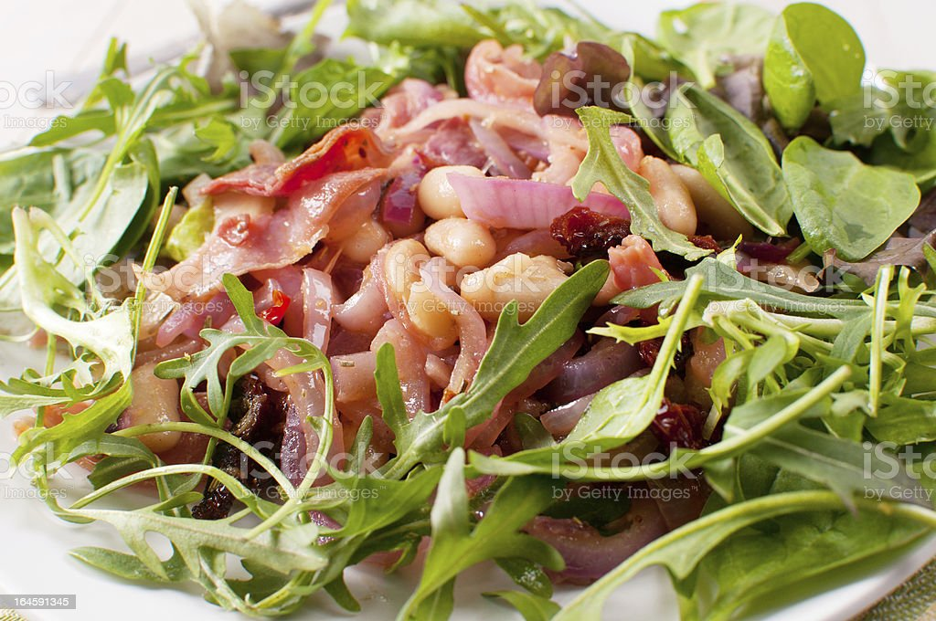 Red green salad with beans and onion royalty-free stock photo