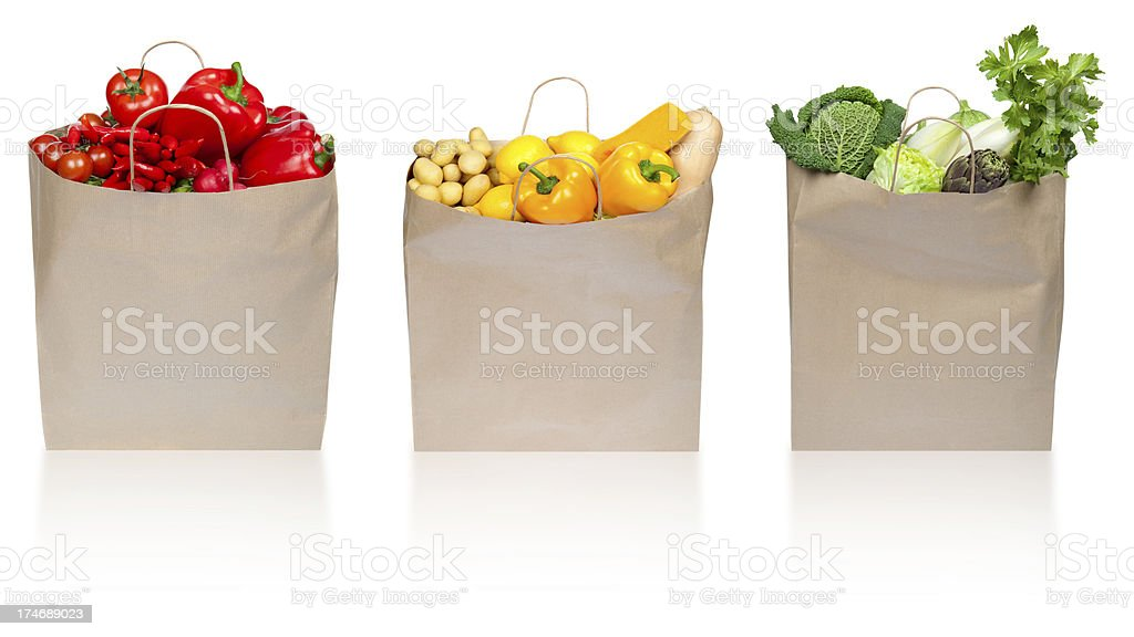 red green yellow vegetable composition in paper shopping bag iso royalty-free stock photo