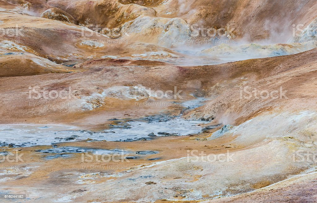 Red Ground ad hot water of Geothermal Landscape Krafla, Iceland stock photo