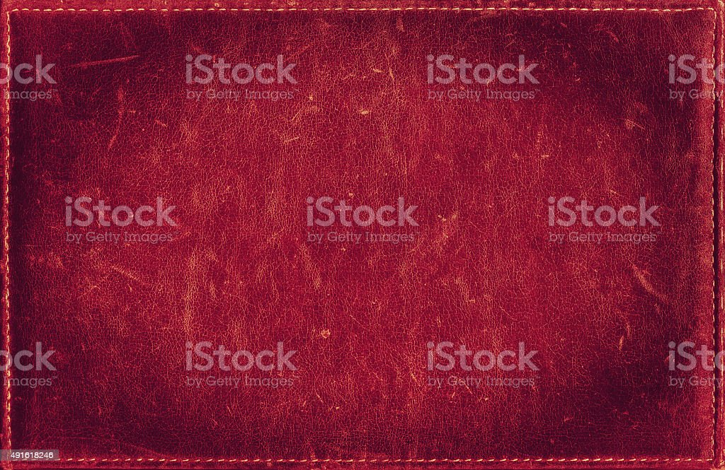 Red grunge background from distress leather texture with stitched frame stock photo