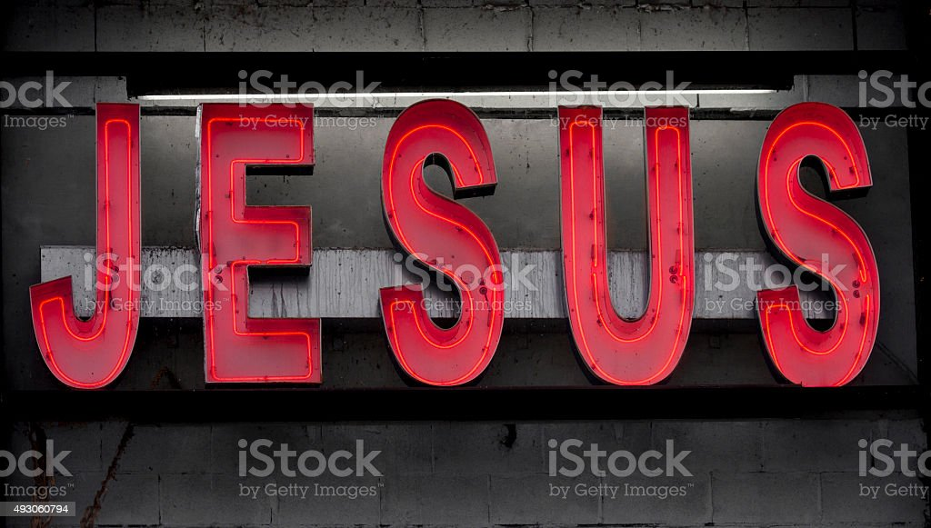 Red Grungy Neon Sign With the Word Jesus stock photo