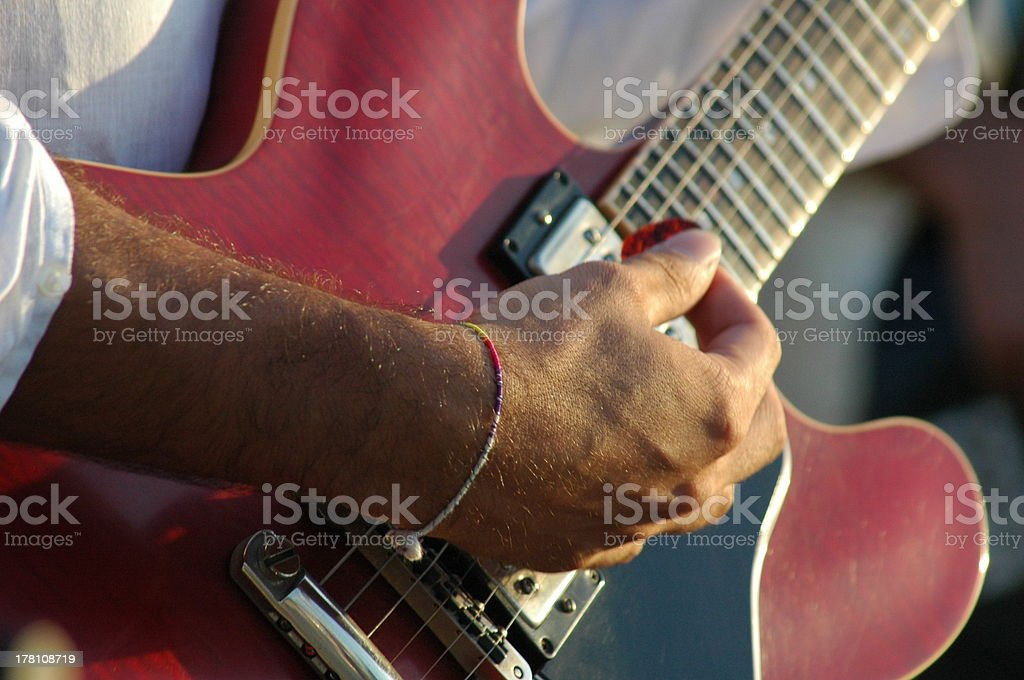 red guitar playing stock photo
