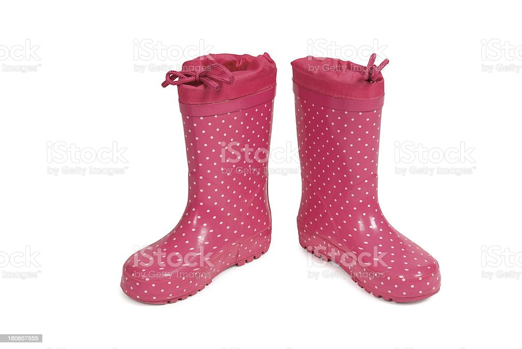 Red gumboots with spots on a white background. royalty-free stock photo