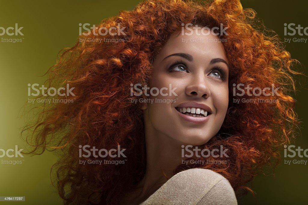 Red Hair. Beautiful Woman with Curly Long Hairstyle. royalty-free stock photo