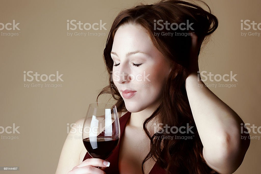 Red hair female drinking wine royalty-free stock photo