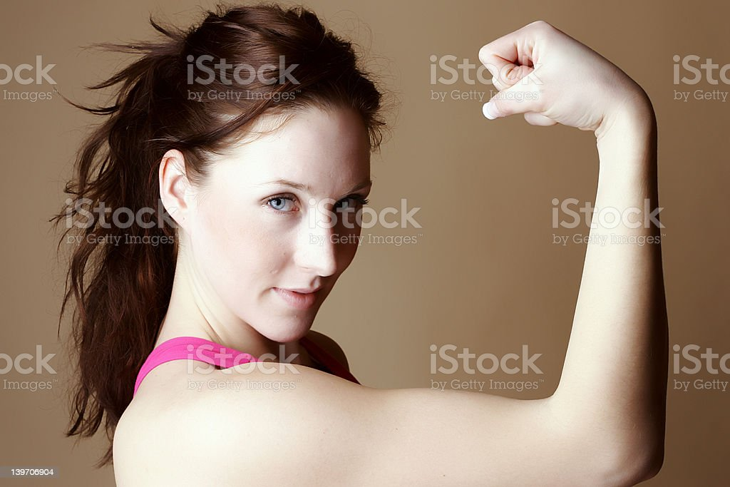 Red hair female in classic fitness position royalty-free stock photo