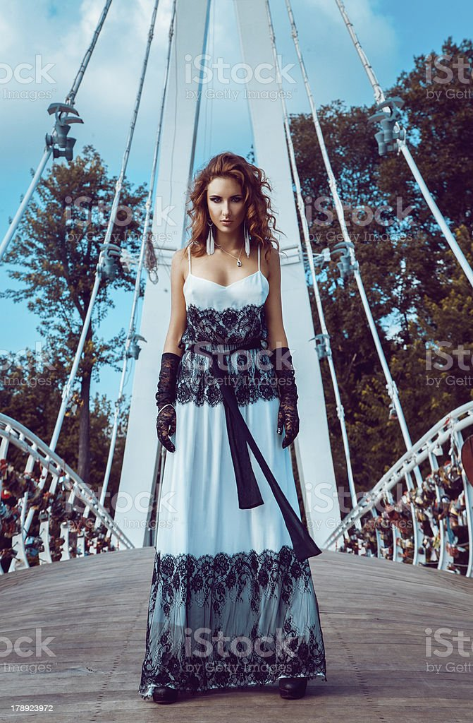 Red hair girl stand on bridge outdoors royalty-free stock photo