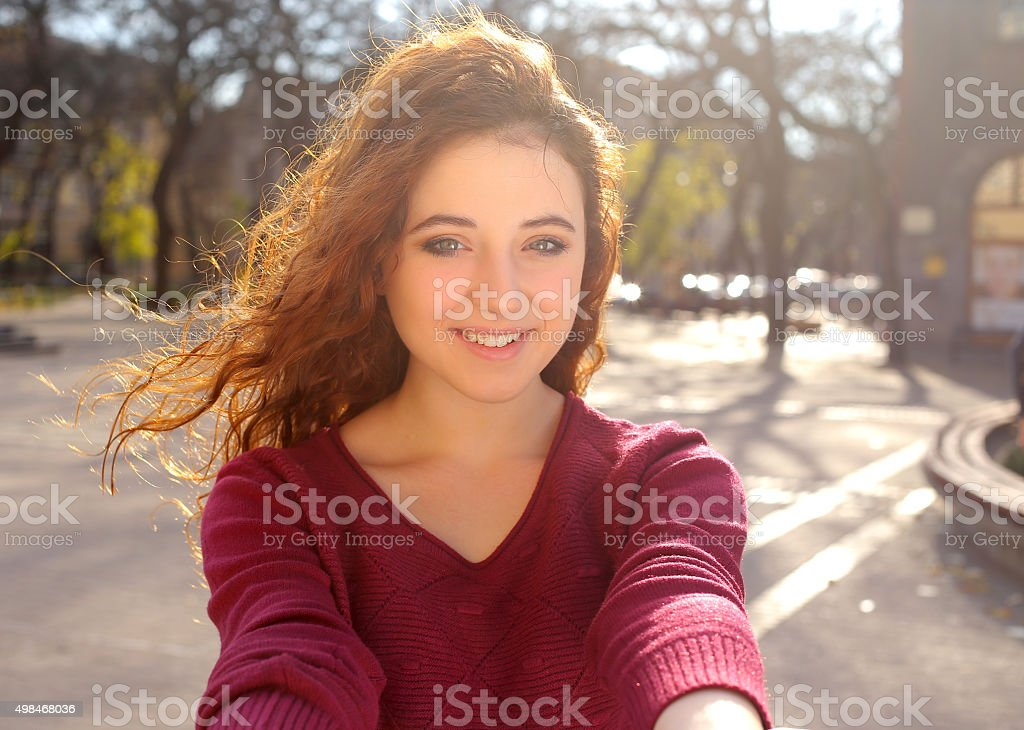 red hair girl taking selfie stock photo