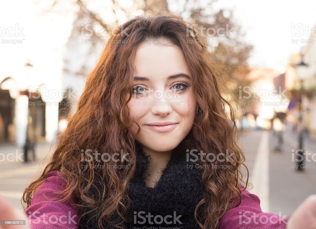 red hair girl taking selfie stock photo