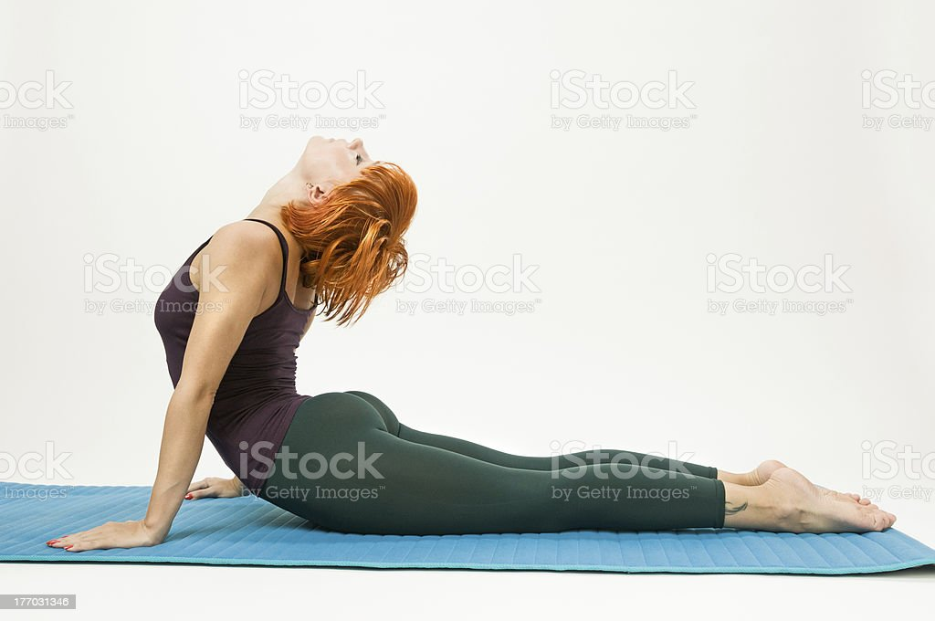 Red hair woman practicing fitness yoga stock photo