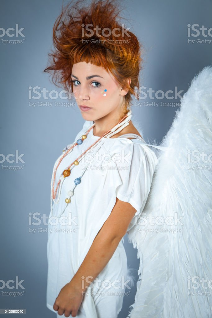 Red haired angel girl stock photo