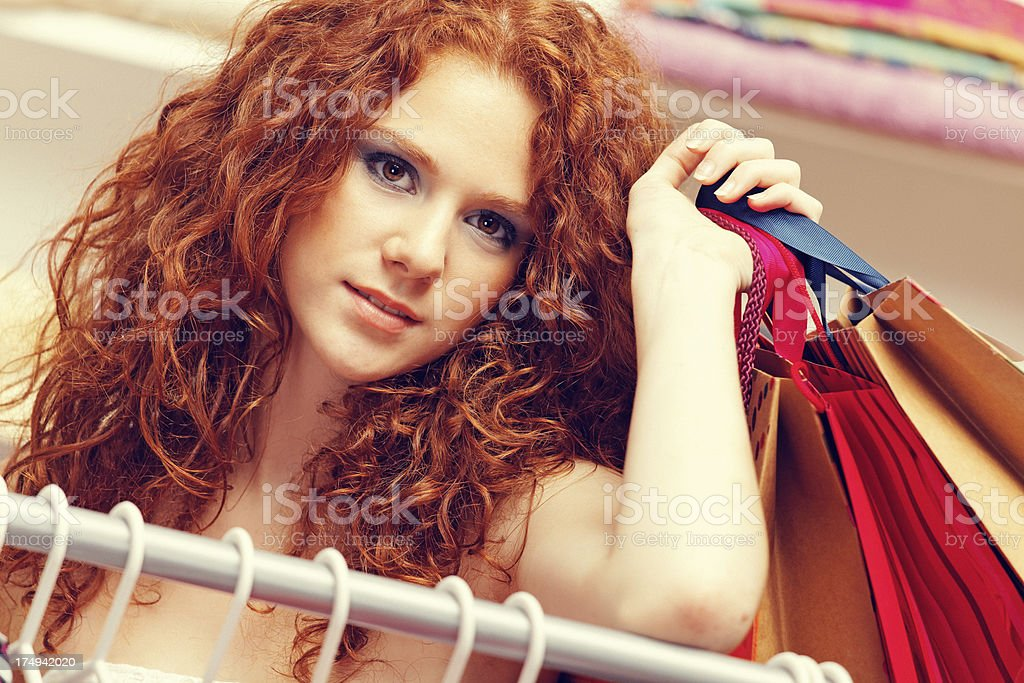red haired beauty shopping in clothing store royalty-free stock photo