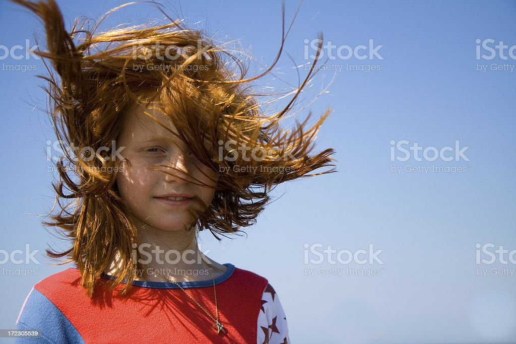 Red haired girl in the wind royalty-free stock photo