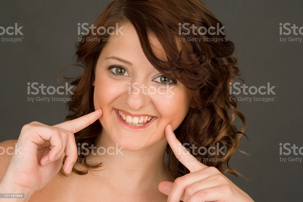 Red Haired Girl with a Big Friendly Smile royalty-free stock photo