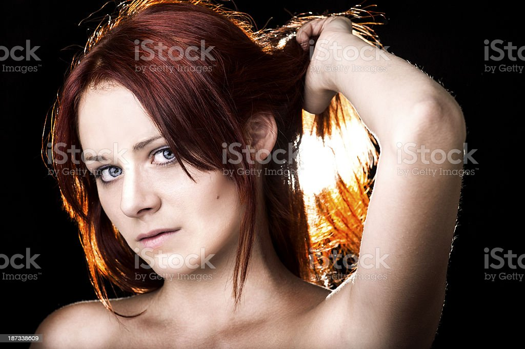 Red Haired woman backlit royalty-free stock photo