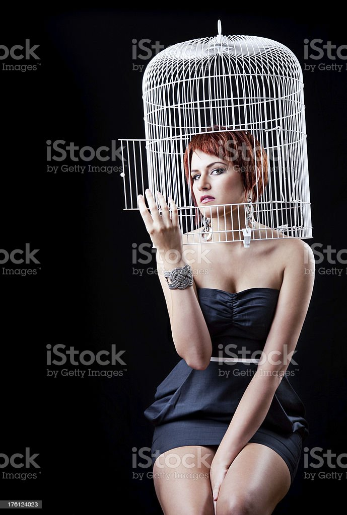 Red Haired Woman In Bird Caged royalty-free stock photo