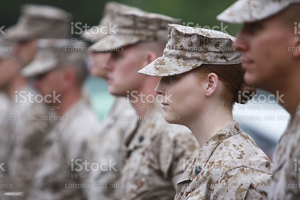 Red Haired Woman Marine in Formation stock photo