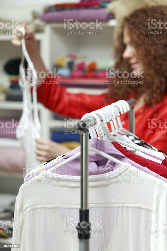 red haired woman shopping in clothing store royalty-free stock photo