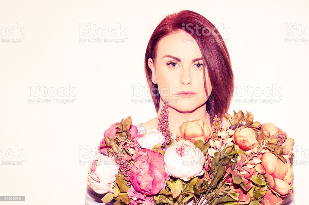 Red haired woman with flowers stock photo