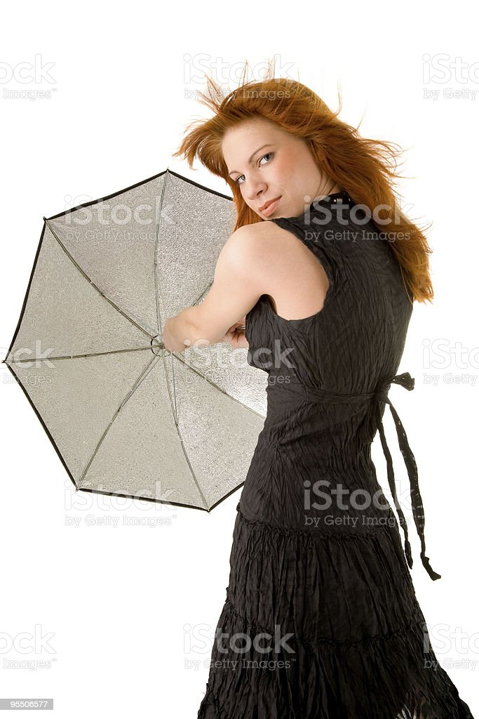 Red haired woman with umbrella stock photo