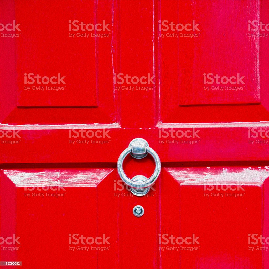 red handle in london antique brown door stock photo
