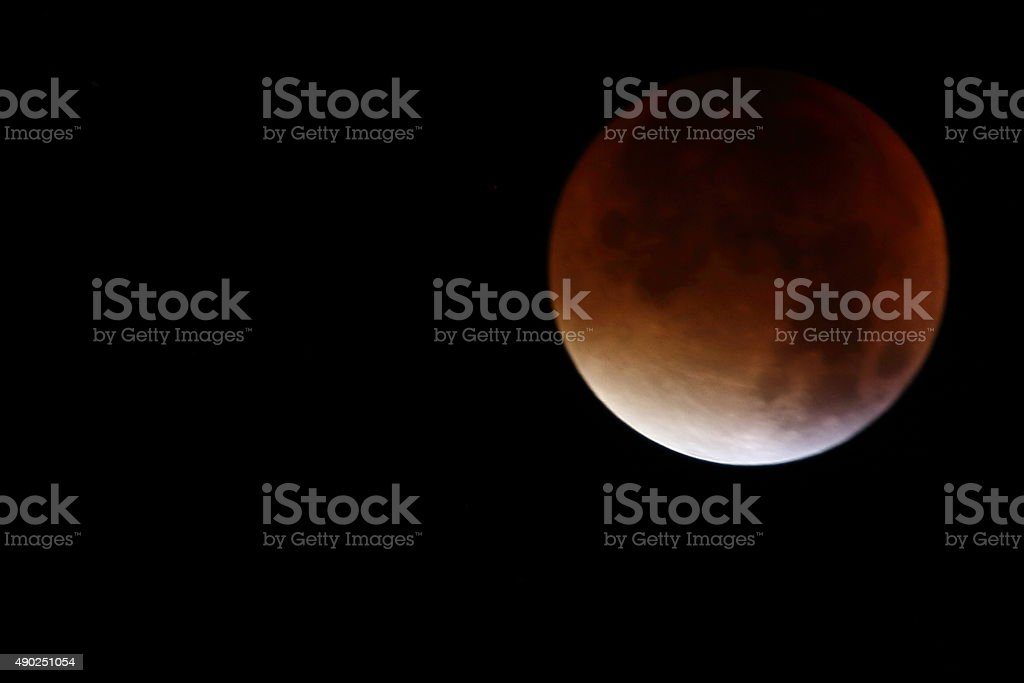 Red Harvest moon on dark sky background stock photo