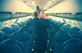 Red Head Flight Attendant Stewardess Demonstrating Oxygen Mask on Plane