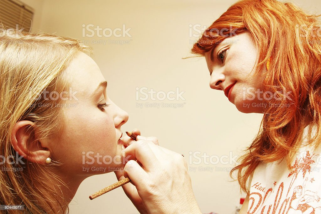 Red Head Makeup Artist Working royalty-free stock photo
