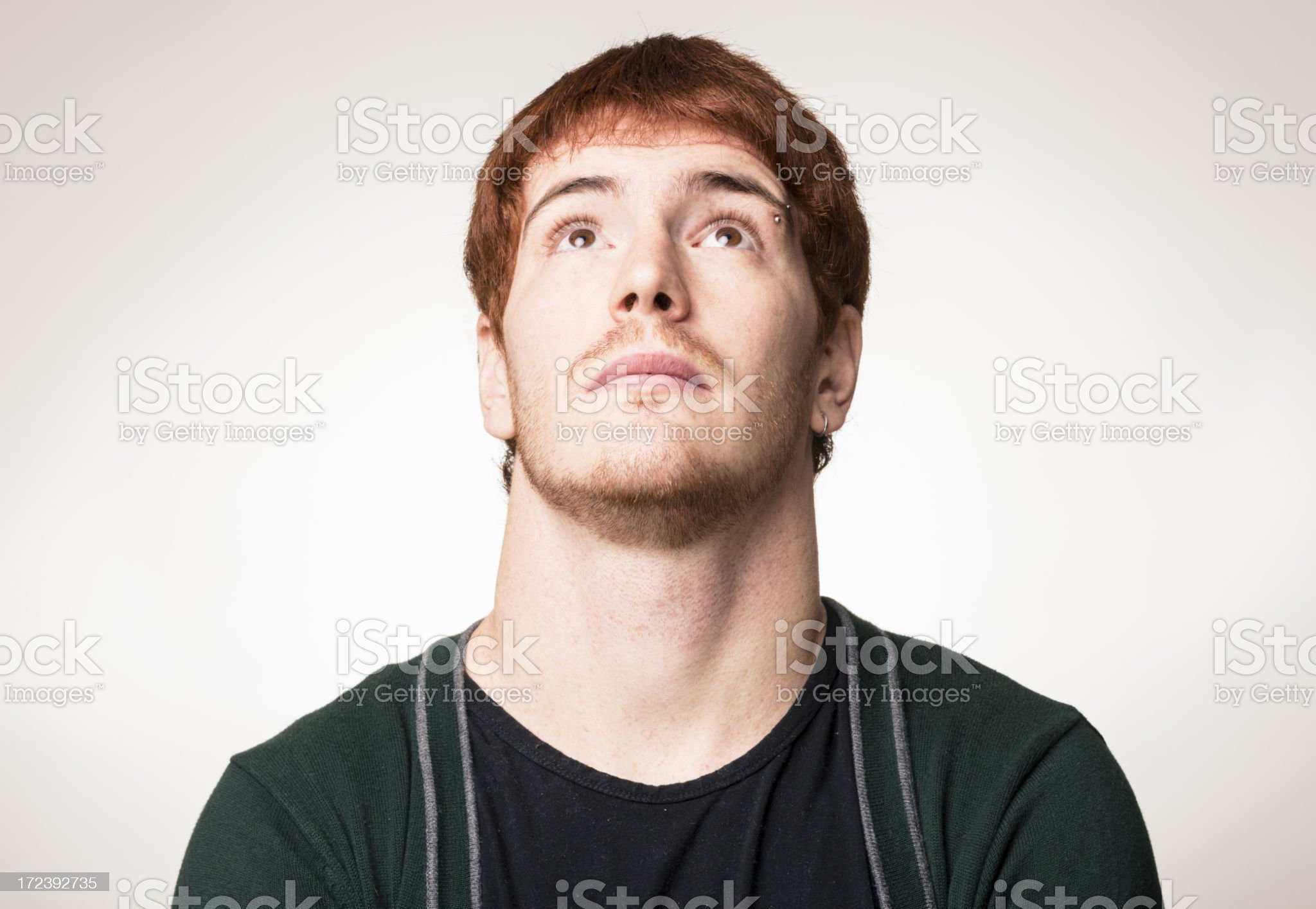 Red head man looking up royalty-free stock photo