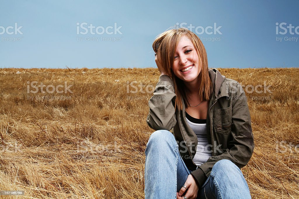 Red Headed Girl Sitting in a Field royalty-free stock photo