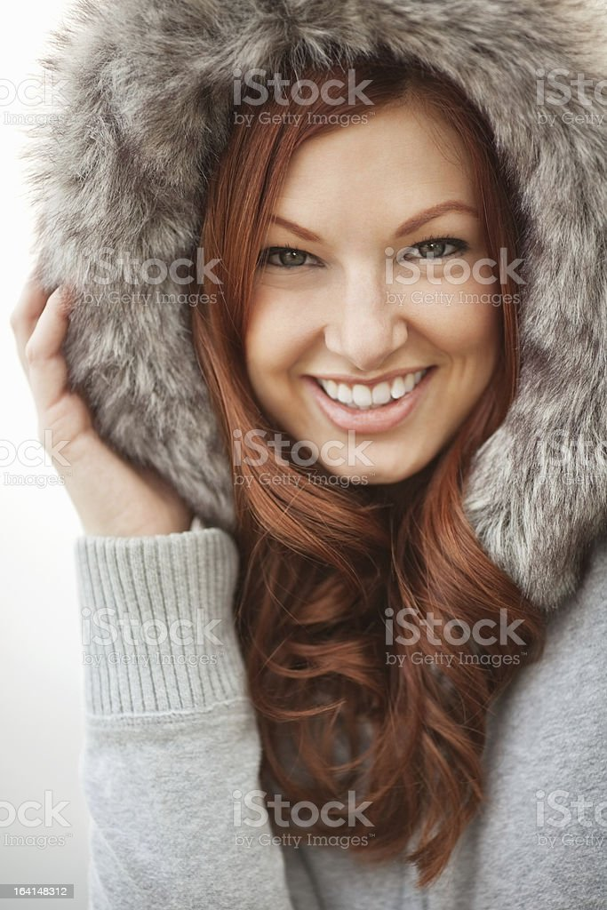 Red Headed Woman in Fur Lined Parka stock photo