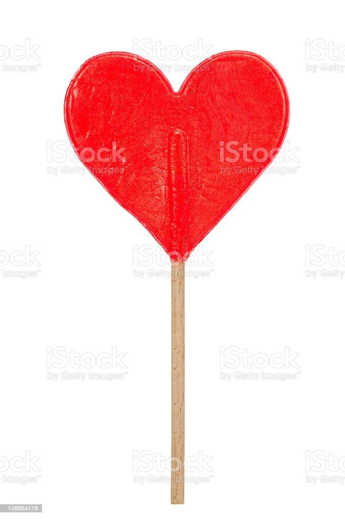 red hear shaped lollipop stock photo