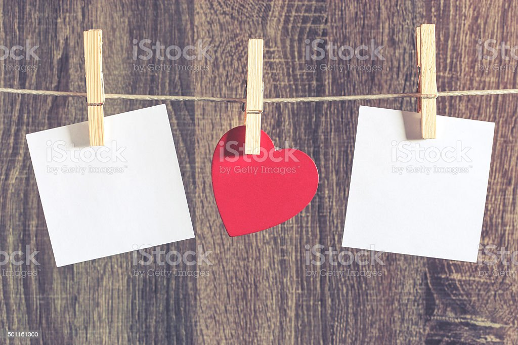 Red heart and blank white cards hanging on a clothesline stock photo