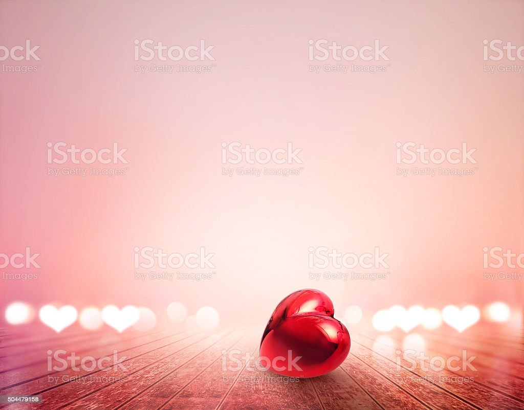 red heart and bokeh on wooden floor vibrant for background stock photo
